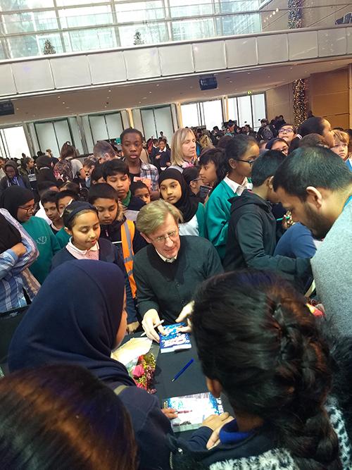 Philip signing